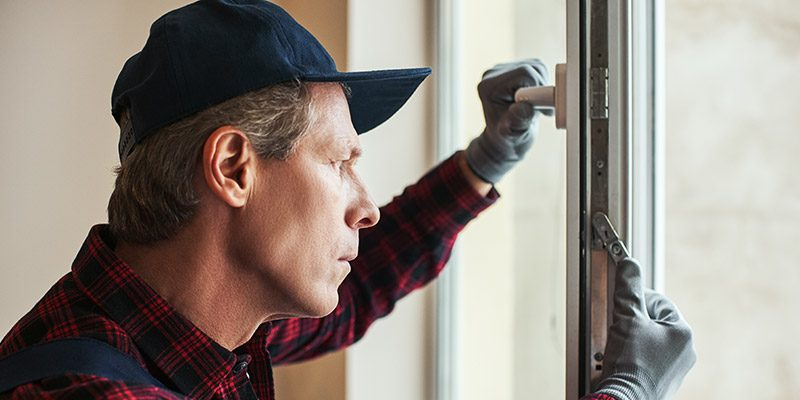 homeowner installing replacement windows